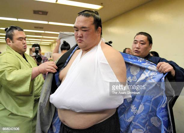 Injured yokozuna Kisenosato is seen in the dressing room during day thirteen of the Grand Sumo Spring Tournament at Edion Arena Osaka on March 24...