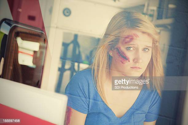 Injured young woman in ambulance