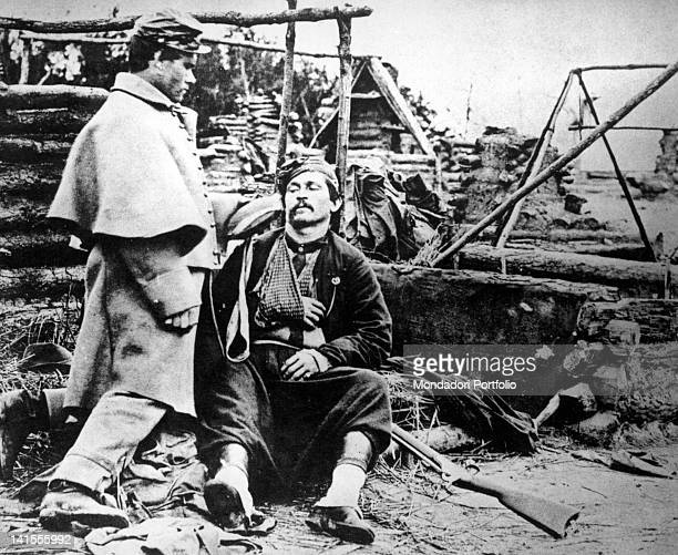 Injured Zouave from Louisiana helped by a fellow soldier during the American Civil War USA January 1862