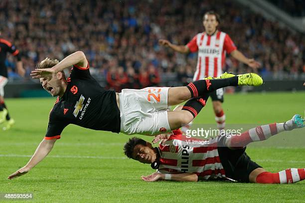 injury of Luke Shaw of Manchester United Hector Moreno of PSV Eindhoven during the UEFA Champions League group B match between PSV Eindhoven and...