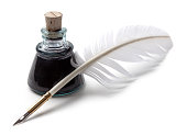 Ink bottle and feather quill pen on white background