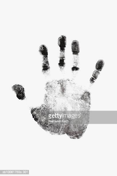 Ink handprint against white background