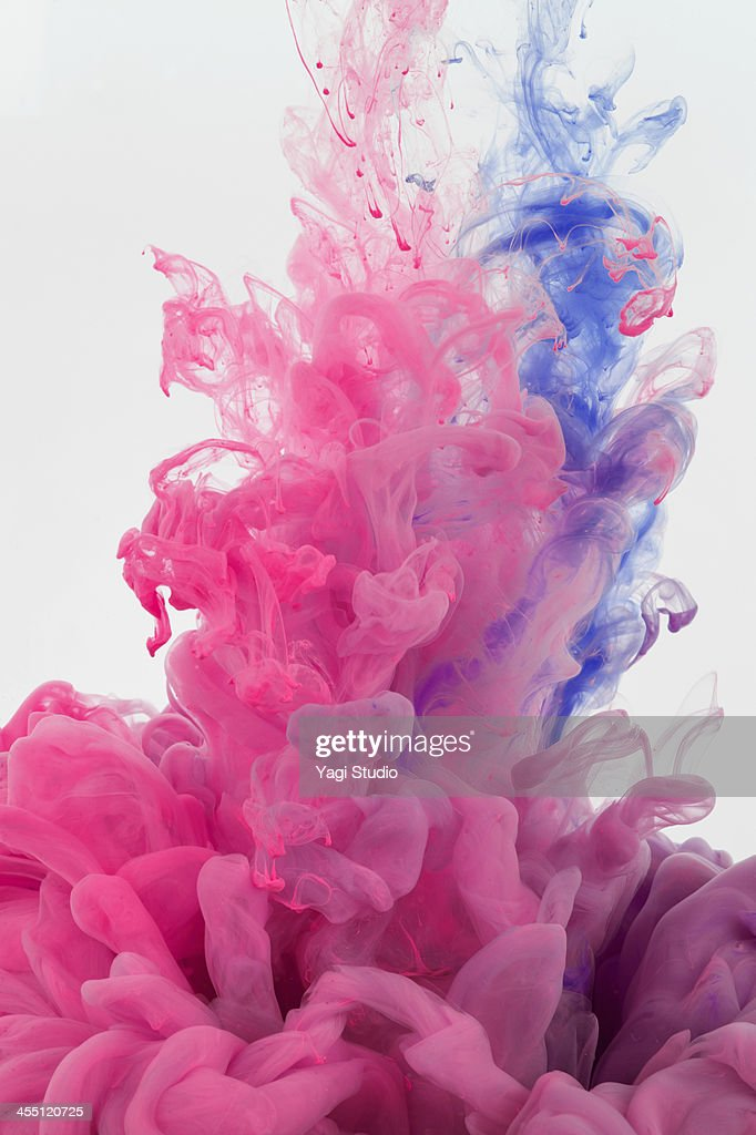 Ink in water on white background : Stock Photo