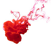 Ink red in the water isolated on white background