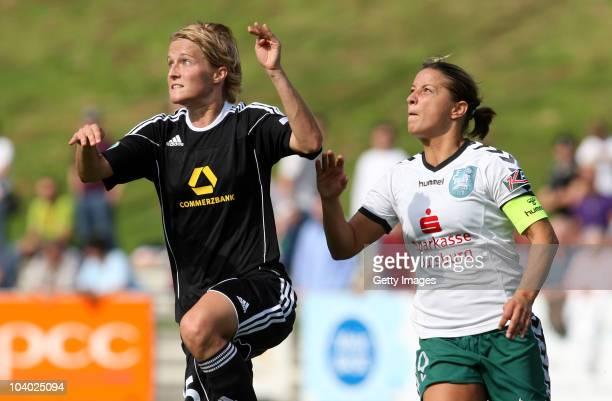 Inka Grings of Duisburg challenges Saskia Bartusiak of Frankfurt during the Women's bundesliga match between FCR Duisburg and FFC Frankfurt at the...