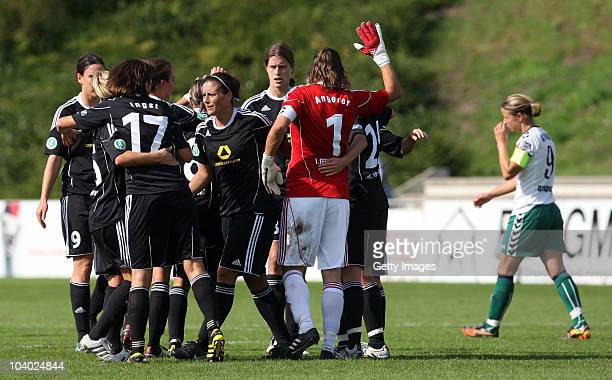 Inka Grings of Duisburg looks dejected whilst Frankfurt players cheer after winning the Women's bundesliga match between FCR Duisburg and FFC...