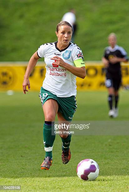 Inka Grings of Duisburg runs with the ball during the Women's bundesliga match between FCR Duisburg and FFC Frankfurt at the PCCStadium on September...