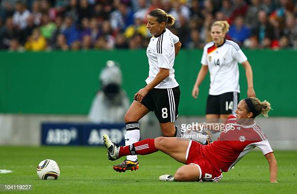 Inka Grings of Germany and Carmelina Moscato of Canada compete for the ball during the Women's International Friendly match between Germnay and...