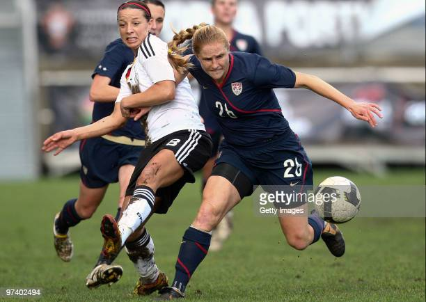 Inka Grings of Germany and Rachel Buehler R of USA battle for the ball during the Women Algarve Cup match between Germany and USA on March 3 2010 in...