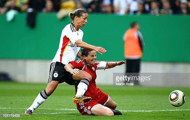 Inka Grings of Germany and Rhian Wilkinson of Canada compete for the ball during the Women's International Friendly match between Germnay and Canada...