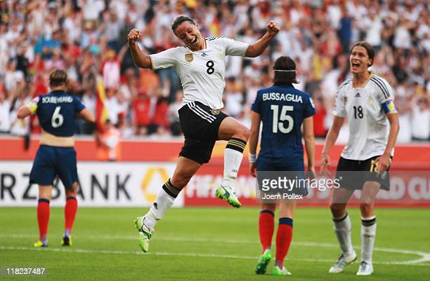 Inka Grings of Germany celebrates after scoring her team's second goal during the FIFA Women's World Cup 2011 Group A match between France and...