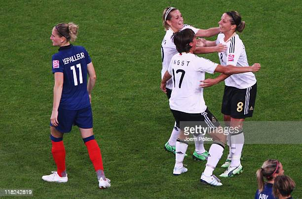 Inka Grings of Germany celebrates with her team mates after scoring her team's third goal during the FIFA Women's World Cup 2011 Group A match...