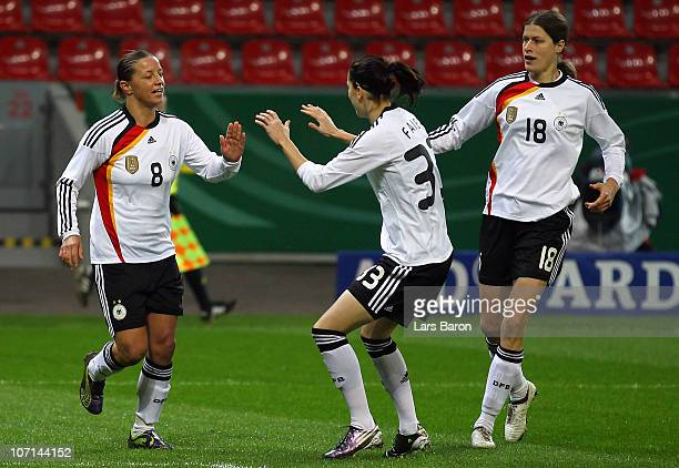 Inka Grings of Germany celebrates with team mates after scoring her team's first goal during the women's international friendly match between Germnay...