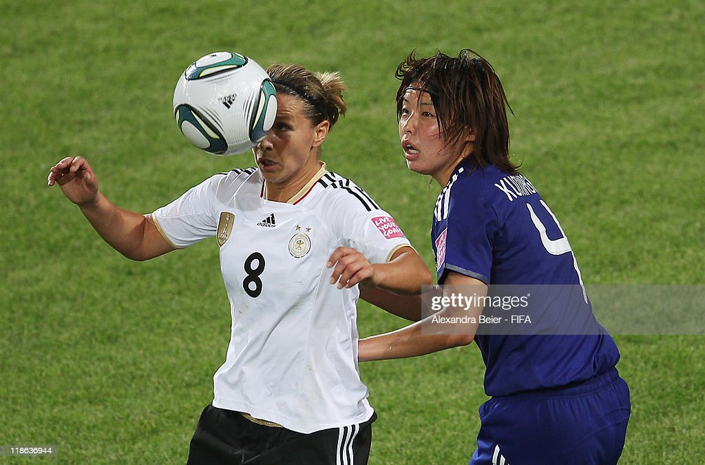 Inka Grings (L) of Germany heads for the ball with Saki Kumagai during the FIFA Women's World Cup quarter finals match between Germany and Japan on July 9, 2011 in Wolfsburg, Germany.
