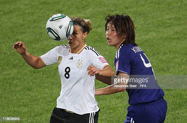 Inka Grings of Germany heads for the ball with Saki Kumagai during the FIFA Women's World Cup quarter finals match between Germany and Japan on July...