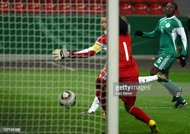 Inka Grings of Germany scores her team's first goal during the women's international friendly match between Germnay and Nigeria at BayArena on...