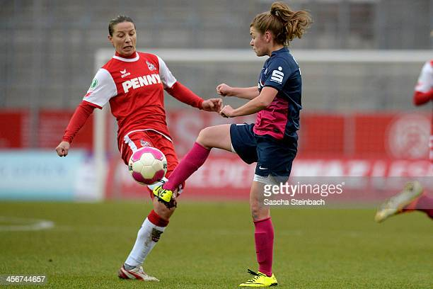 Inka Grings of Koeln and Linda Dallmann of Essen battle for the ball during the Women's DFB Cup match between SGS Essen and 1 FC Koeln at Stadion...