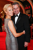 Inken Oettinger and her husband Guenther Oettinger arrive at the Bambi Awards 2014 on November 13 2014 in Berlin Germany