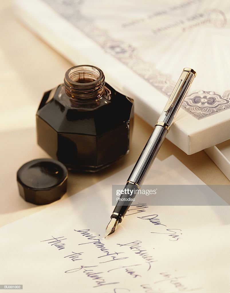 Inkwell and a Fountain Pen : Stock Photo