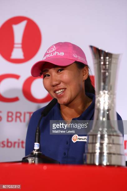 InKyung Kim of Korea answers questions from the media at a press conference following her victory during the final round of the Ricoh Women's British...