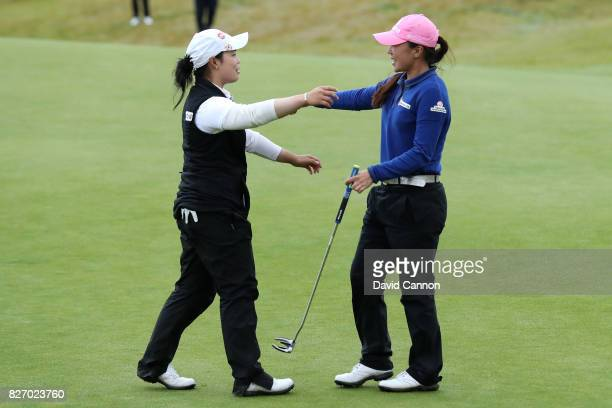 InKyung Kim of Korea celebrates victory on the 18th green with Moriya Jutanugarn of Thailand during the final round of the Ricoh Women's British Open...