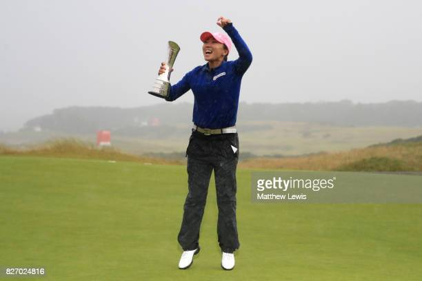 InKyung Kim of Korea celebrates with the trophy following her victory during the final round of the Ricoh Women's British Open at Kingsbarns Golf...