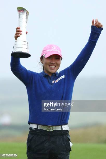 InKyung Kim of Korea poses with the trophy following her victory during the final round of the Ricoh Women's British Open at Kingsbarns Golf Links on...