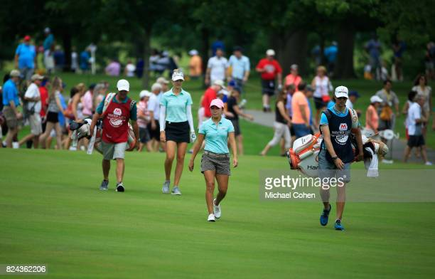 InKyung Kim of South Korea and Nelly Korda of the United States walk the fairway during the fourth and final round of the Marathon Classic Presented...