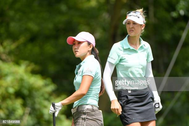 InKyung Kim of South Korea and Nelly Korda watch the tee shot by Kim on the 8th tee during the final round of the LPGA Marathon Classic at Highland...