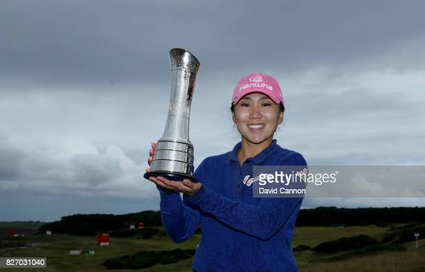 InKyung Kim of South Korea holds the trophy after her victory during the final round of the Ricoh Women's British Open at Kingsbarns Golf Links on...