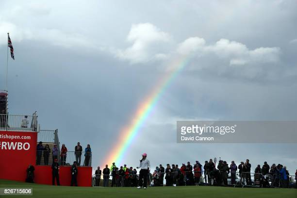 InKyung Kim of South Korea holes her par putt on the 18th green as a raoinbow forms behind the crowds during the third round of the Ricoh Women's...