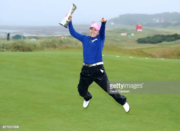 InKyung Kim of South Korea leaps for joy with the trophy after her victory during the final round of the Ricoh Women's British Open at Kingsbarns...