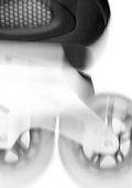 In-line skate, blurred, close-up, b&w.