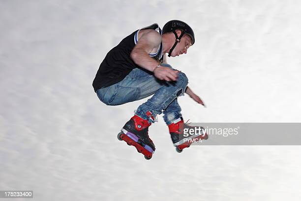 Inline skater flies through the air after jumping off a kicker at the White Air festival Brighton UK