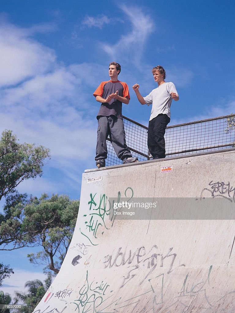 In-line skaters standing on ramp : Stock Photo