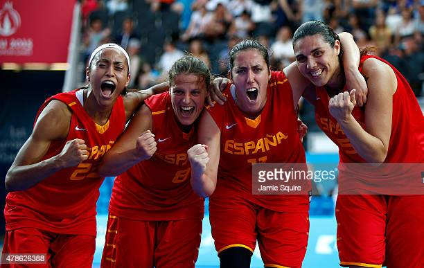 Inmaculada Zanoguera Garcias Maria Aranzazu Gomez Novo Vega Gimeno Martinez and Rita Esther Monenegro Santana of Spain celebrate winning bronze after...