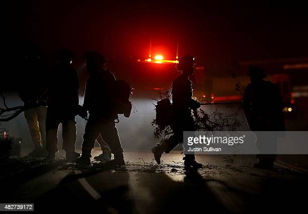 Inmate fire crews clear brush from the side of highway 20 ahead of the Rocky Fire on August 2 2015 near Clearlake California Over 1900 firefighters...