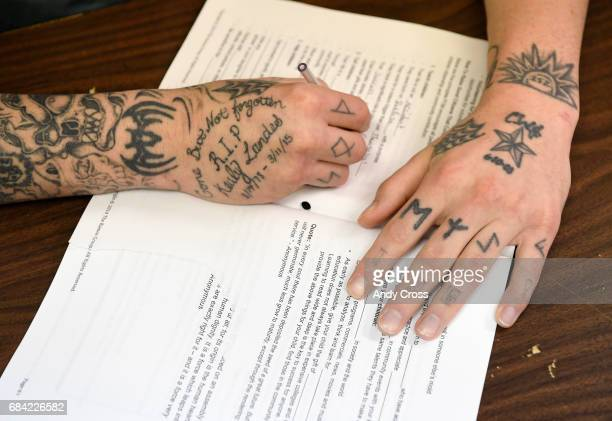 Inmate Joseph Hayes writes in his workbook during a parenting class at the Colorado State Penitentiary May 03 2017 in Canon City Colorado Classes are...