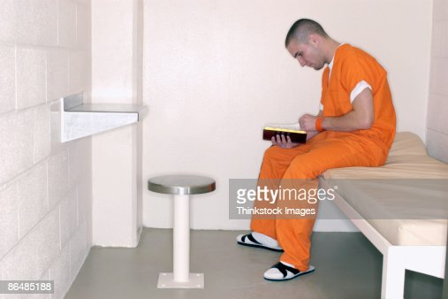 Inmate reading bible