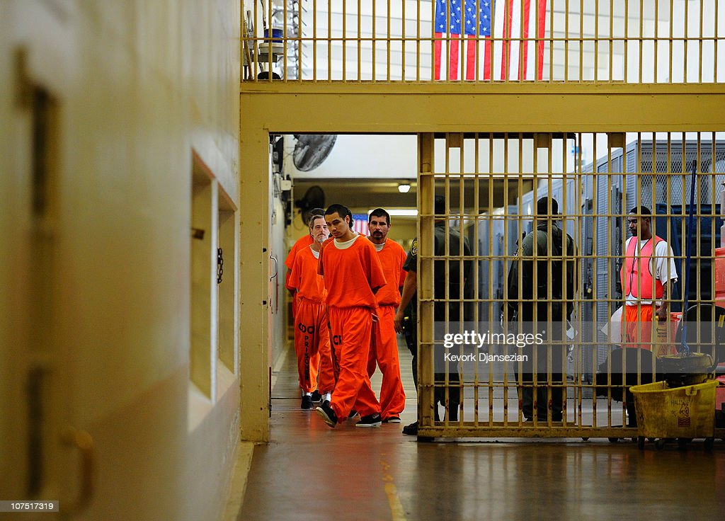 Inmates at Chino State Prison walk the hallway on December 10 2010 in Chino California The US Supreme Court is preparing to hear arguments to appeal...