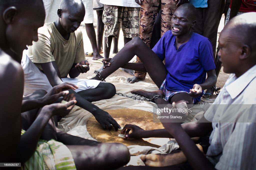 CONTENT] Inmates at Rumbek prison in South Sudan play dominoes, to while away the days.