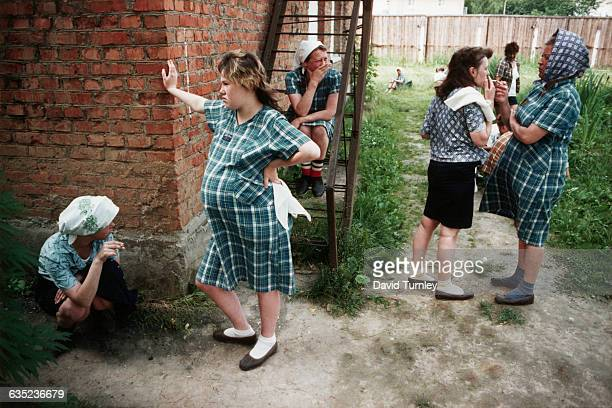 Inmates at the Mozhaysk Women's Prison wait outdoors to begin their shift in the prison's textile mill which produces uniforms for Soviet police |...