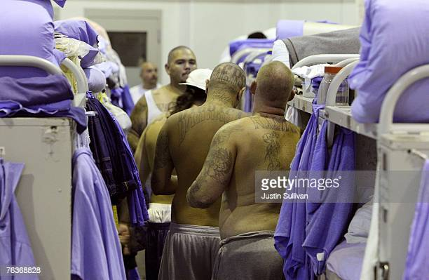 Inmates at the Mule Creek State Prison crowd between bunk beds in a gymnasium that was modified to house prisoners August 28 2007 in Ione California...