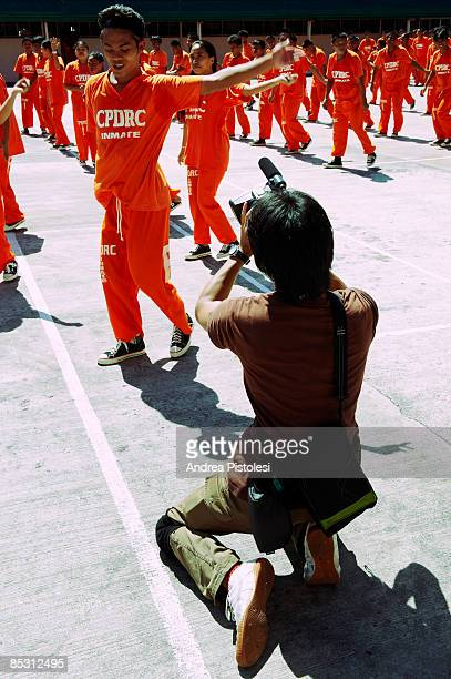Inmates dancing in front of a Japanese camera crew at CPDRC Prison The Inmates Dance Training Show is a rehabilitation program at the prison that has...