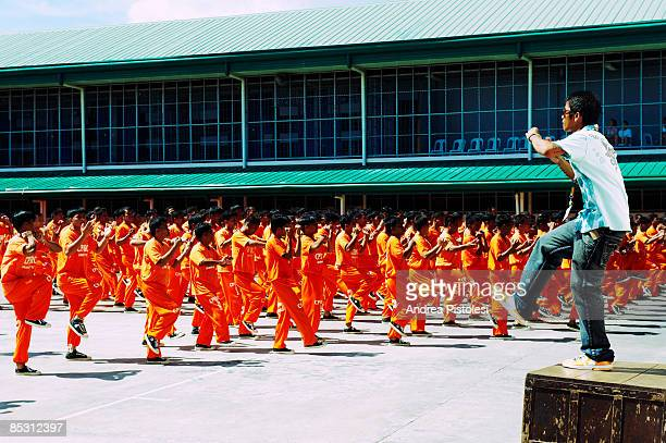 Inmates dancing in front of the dance director at CPDRC Prison The Inmates Dance Training Show is a rehabilitation program at the prison that has...