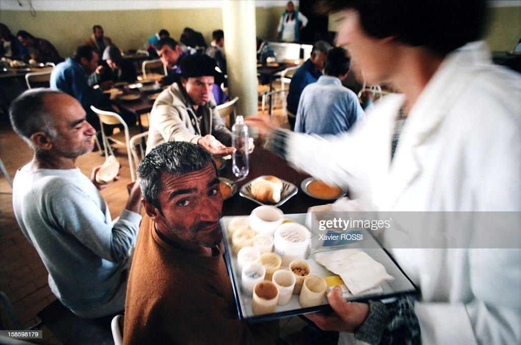 Inmates having meal at the psychiatric hospital of Shtinje in September, 1999 in Kosovo.