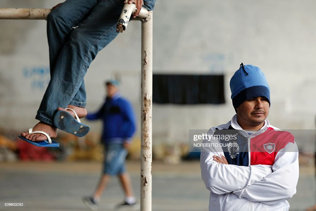 Inmates in a courtyard in Tacumbu prison in Asuncion, Paraguay on Apr. 30, 2016. Tacumbu prison, Paraguay's largest, was built to hold 1,500 inmates but currently houses some 4,000, guarded by 45 poorly-trained guards per shift. Overcrowding, drug dealing, violence, and privileges for a handful of inmates held in so-called VIP cells are part of alarming conditions that undermine human dignity. / AFP / NORBERTO