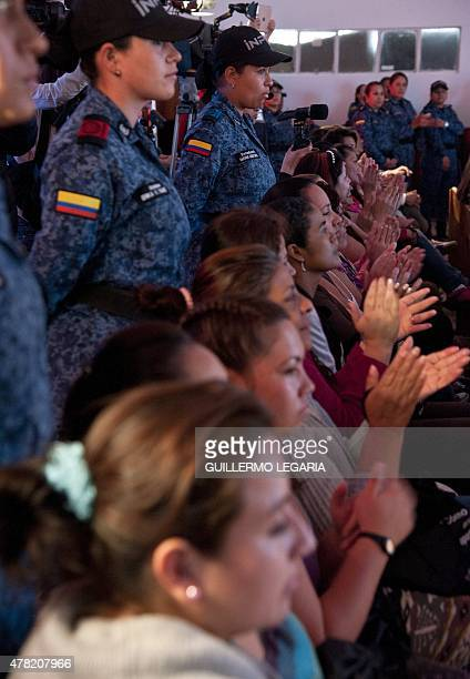 Inmates of 'El Buen Pastor' women's prison applaud during a TEDx motivational talk on June 23 2015 in Bogota Colombia AFP PHOTO/Guillermo LEGARIA