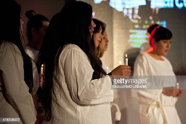 Inmates of 'El Buen Pastor' women's prison perform during a TEDx motivational talk on June 23 2015 in Bogota Colombia AFP PHOTO/Guillermo LEGARIA