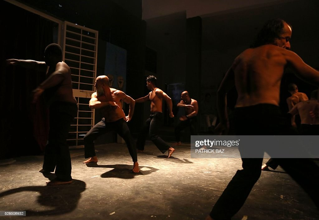 Inmates of Lebanon's Roumieh main prison rehearse for a play dubbed 'Johar...Up in the air' at the prison theatre on May 5, 2016, West of the capital Beirut. The theatre play by Lebanese actress and director Zeina Daccache is part of the framework 'The Untold Story of Forgotten Behind Bars', a project implemented by the Lebanese NGO Catharsis and funded by the European Union. The project objective revolves around the improvement of mental health in Lebanese prisons and a suitable legislation for mentally ill inmates and inmates sentenced to life. / AFP / Catharsis / PATRICK BAZ